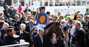 Donnacha O'Brien celebrates after winning the Investec Oaks on  Forever Together at the  Derby Festival at Epsom. Photograph: John Walton/PA Wire.