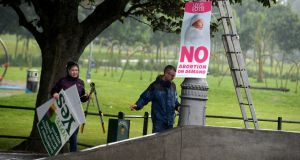 Referendum posters being removed in Fairview, Dublin, last week. File photograph: Cyril Byrne/The Irish Times