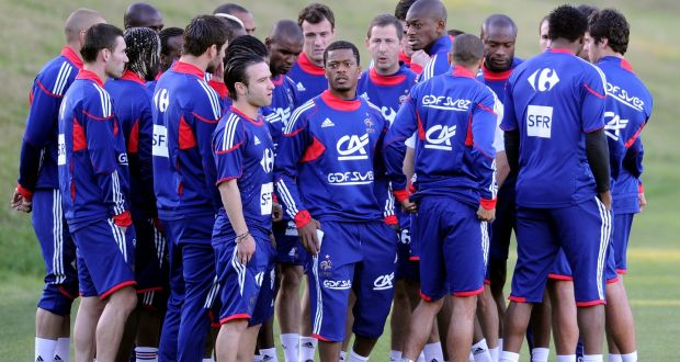 f09b7a1be France captain Patrice Evra (c) meets with teammates after a clash with  coach Raymond