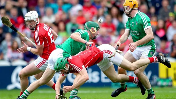 Cork's Pat Horgan and Seamus Harnedy clash with Sean Finn and Richie English of Limerick. Photo: James Crombie/Inpho