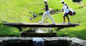 Rory McIlroy of Northern Ireland crosses a bridge to the 17th green during the third round of the Memorial Tournament Presented by Nationwide at Muirfield Village Golf Club in Dublin, Ohio. Photo: Sam Greenwood/Getty Images