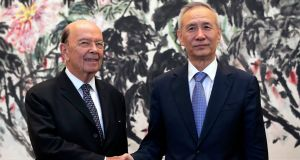 US commerce secretary Wilbur Ross (left)  shakes hands with Chinese vice-remier Liu He. Photograph: AP