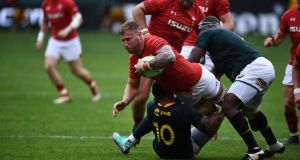 Ross Moriarty is tackled by South Africa's Elton Jantjies during Wales' win in Washington. Photograph: Brendan Smialowski/AFP