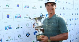 Thorbjorn Olesen of Denmark with the Italian Open trophy. Photograph:  Andrew Redington/Getty