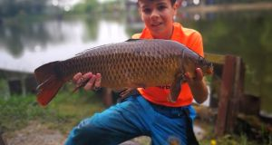 John Brown with a fine carp from Oaklands Fishery