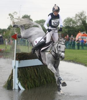 At Tattersalls International Horse Trials Britain's Caroline March on Postmaster manages to stay on board after a mistake at the water jump during the Cross Country round. Photograph: Lorraine O'Sullivan