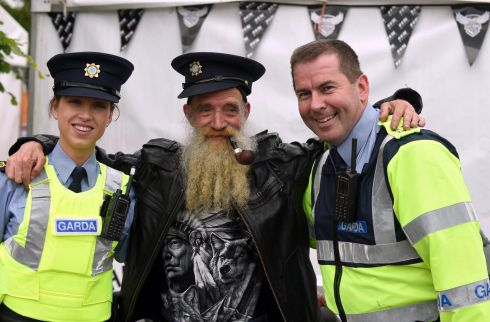 Biker Tommy Guirey from Kilmeaden, Co Waterford enjoys a jocular moment with Garda Heather Kate Burke and Garda Eddie Walshe at Ireland Bikefest in the Gleneagle Hotel, Killarney, at the weekend. Photograph: Don MacMonagle