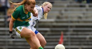 Kerry's  Andrea Murphy scores a goal despite the efforts of  Waterford defender Megan Dunford during the TG4 Munster  Championship semi-final match  at Fitzgerald Stadium in Killarney. Photograph:  Matt Browne/Sportsfile