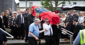 Mourners carry the coffin draped with a Munster flag as Ennis Rugby Club members provide a guard of honour at the funeral of Jack Kenneally at Ennis Cathedral on Sunday morning.