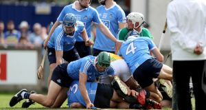 Players pile up in the Dublin goal during the Leinster SHC clash with Offaly. Photo: Oisin Keniry/Inpho