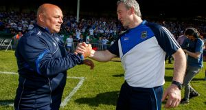 Waterford's manager Derek McGrath and Tipperary's manager Michael Ryan at the final whistle of their Munster SHC clash. Photo: James Crombie/Inpho