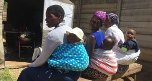 Women wait to have their babies vaccinated at a Harare hospital. Photograph: Harry McGee