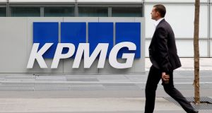 Global auditor KPMG said on Monday it will lay off up to 400 people in South Africa, in its latest shake-up following a corruption scandal that saw it lose several major clients. Photograph: Charles Platiau/Reuters