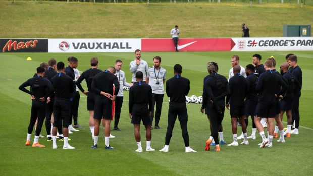 England assistant coach Steve Holland speaks to the players while manager Gareth Southgate looks on during a training session at St George's Park, Burton. . Photograph: Nick Potts/PA Wire.