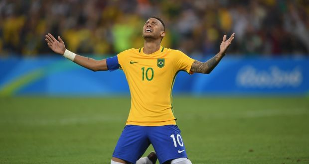 4afe36ad12 Brazil striker Neymar celebrates scoring the winning penalty in the  shootout against Germany at the Rio