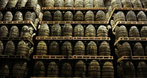 American oak barrels containing Jameson whiskey, produced by Irish Distillers Ltd., are seen stacked at the Midleton distillery.  Businessman John Teeling has warned that there may be a scarcity of the Irish spirit within the next few years due to surging global demand. Photograph: Aidan Crawley/Bloomberg