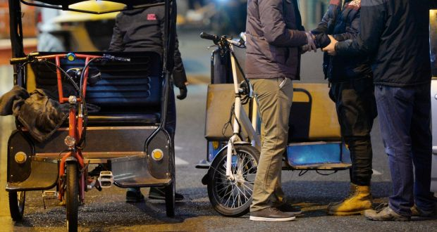 Undercover gardaí search and arrest a rickshaw driver on Suffolk Street, Dublin. Photograph: Alan Betson