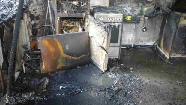 The fire damage to a tall fridge-freezer inside the kitchen of flat 16 of Grenfell Tower where the fire is believed to have started. Photograph: Grenfell Tower Inquiry/Getty Images