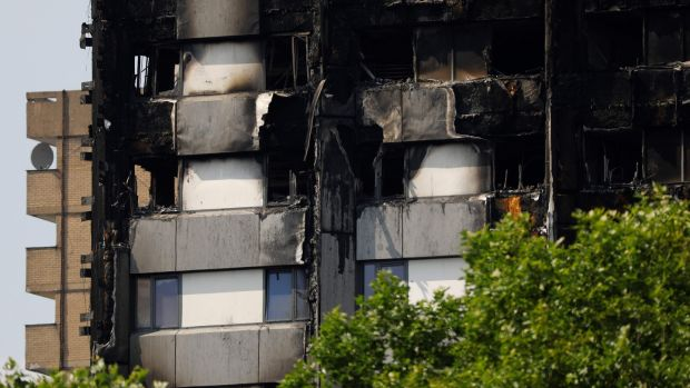 Unburned lower Grenfell Tower block floors with untouched cladding in place in North Kensington, west London. Photograph: Getty Images