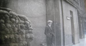 Ernie O' Malley standing outside the Four Courts, June 1922