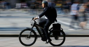 E-bikes do not require motor tax or insurance once they are pedal assisted and do not travel at more than 25 km/h. At least for now. Photograph: Stefano Rellandini/Reuters