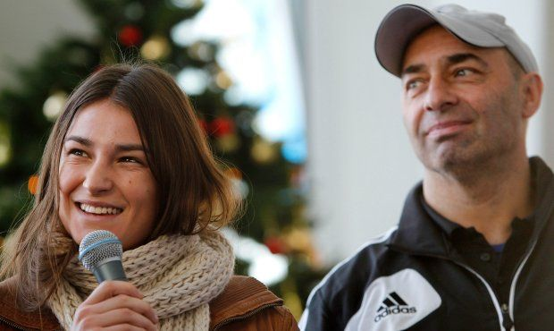 Boxing coach Pete Taylor with his daughter, Olympic gold medallist Katie Taylor. File photograph: Julien Behal/PA