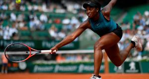 Sloane Stephens returns the ball to Daria Kasatkina during their women's singles quarter-final match on day ten of the Roland Garros 2018 French Open. Photo: Christophe Simon/Getty Images