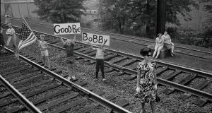 Children bearing signs greet Robert F Kennedy's funeral train as it passed near Elizabeth, New Jersey, in 1968. Photograph: William Sauro/The New York Times