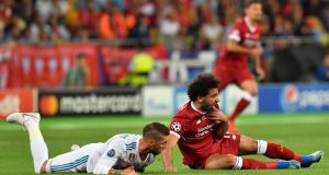 Real Madrid's Sergio Ramos and Mohamed Salah of Liverpool clash during the Champions League final. Photo: Georgi Licovski/EPA