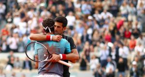 Novak Djokovic congratulates Marco Cecchinato on victory in their men's singles quarter finals match during day ten of the 2018 French Open at Roland Garros. Photo: Cameron Spencer/Getty Images