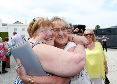 TOGETHER AGAIN: Eileen Maguire, Loughlinstown, and Mary Rossiter, Loughlinstown, hug at Áras an Uachtaráin as President Michael D Higgins and Sabina Higgins hosted a historic gathering of over 220 women who lived and worked in Magdalene Laundries. The event marked the first time that survivors of the laundries from Ireland, the UK, the US and Australia were brought together. Photograph: Maxwellphotography.ie