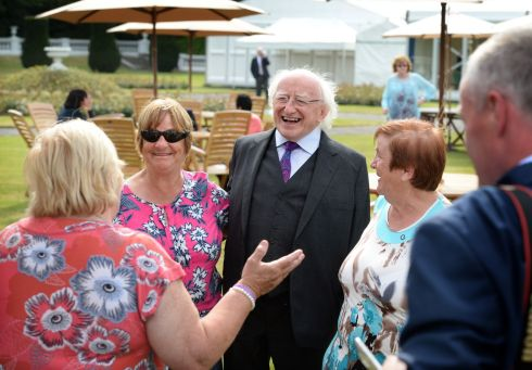 SPECIAL RECEPTION: President Michael D Higgins with a group of friends (from left), Roseanna Murphy, Mairead Manley and Breda Kennedy, who spent time in Goldenbridge together, as the President hosted a gathering of over 220 women who worked in Magdalene Laundries, at a reception at Áras an Uachtaráin. Photograph: Dara Mac Dónaill/The Irish Times