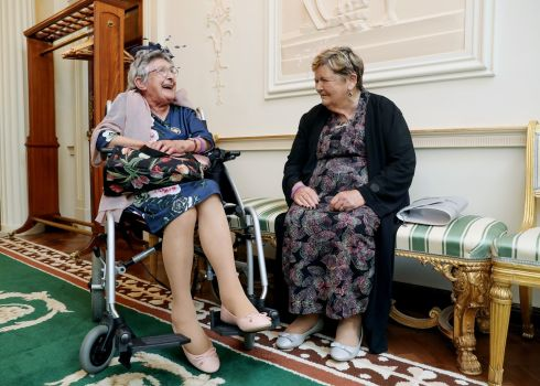 MAGDALENES UNITE: Dolores Cassely of Dublin (left) and Rose Harris, also of Dublin, at Áras an Uachtaráin for President Michael D Higgins's gathering of over 220 women who worked in the Magdalene Laundries, at a special reception. Photograph: Maxwellphotography.ie