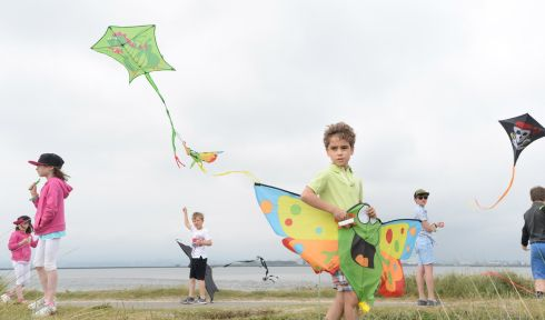 GO FLY A KITE: Eoin Carroll (at front) and other youngsters practise their kite-flying skills at the launch of the Dublin Kite Festival 2018, running on Sunday 10th June on the North Bull Island, Clontarf, Dublin. Photograph: Dara Mac Dónaill/The Irish Times