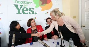 Sinn Féin's vice president and Northern leader Michelle O'Neill (right) shaking hands with members of the Together for Yes group who campaigned for the repeal of the Eighth Amendment. File photograph: Niall Carson/PA Wire.