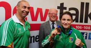 Katie Taylor with her father Pete Taylor (left): home town fight was deemed impossible  due to security issues around boxing. Photograph: Aidan Crawley