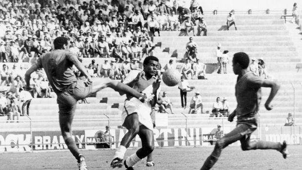 Moroccan defender Khanousi Moulay Idriss challenges Peru's Teofilo Cubillas at the 1970 World Cup. Photograph: Getty Images