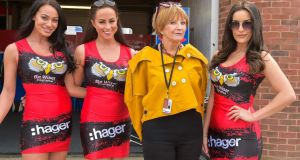 Anne Robinson poses with Brands Hatch grid girls she interviews for The Trouble With Women. Photograph: BBC/Wild Pictures/Rico Patel