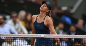 Russia's Maria Sharapova reacts during her women's singles quarter-final match at the French Open against Spain's Garbine Muguruza. Photo: Christophe Archambault/Getty Images