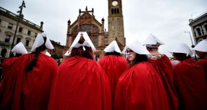 Pro-choice supporters wear robes inspired by The Handmaid's Tale in Derry. Photograph: Charles McQuillan/Getty Images