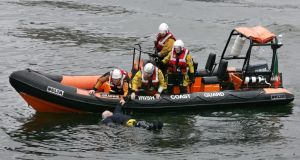 File photograph showing members of the Irish Coastguard (Howth/Skerries Division) taking part in a rescue exercise on the Liffey. Photograph: Matt Kavanagh/The Irish Times