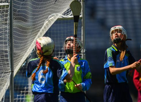 Scoil Lorcain, Baile na Manach, players, from left, Lucy Ní Airtnéada, Mia Ní Dhúnaigh, and Evanne Ní Thóibín watch a point go over against Rush NS in the Corn Haughey. Photo: Piaras Ó Mídheach