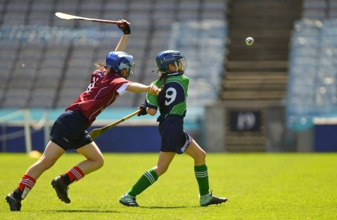 Maggie Donaghy of Loreto PS, Rathfarnham, in action against Iseult Costello of St. Brigid's NS, Castleknock, in the Corn Bean Ui Phuirseil Final. Photo: Piaras Ó Mídheach/Sportsfile
