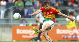 Carlow's Paul Broderick kicking  a free against Kildare. He  has already scored 3-65  in 2018. Photograph: Ken Sutton/Inpho