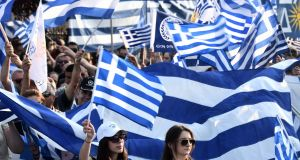 Protesters wave Greek flags in a demonstration to protest against the use of Macedonia in the name of the state on Greece's northern border. Photograph: Sakis Mitrolidis/AFP/Getty Images