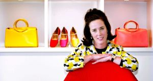 Designer Kate Spade poses with handbags and shoes in 2004 from her collection in New York. File photograph: Bebeto Matthews/AP