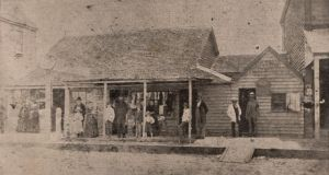"Hunting down an informer: Hubert Patrick Macklin, ""the tall-hatted tall man to the extreme right of the verandah"", outside the Star Hotel in Kempsey, New South Wales, around 1885. Photograph: Macleay Chronicle"