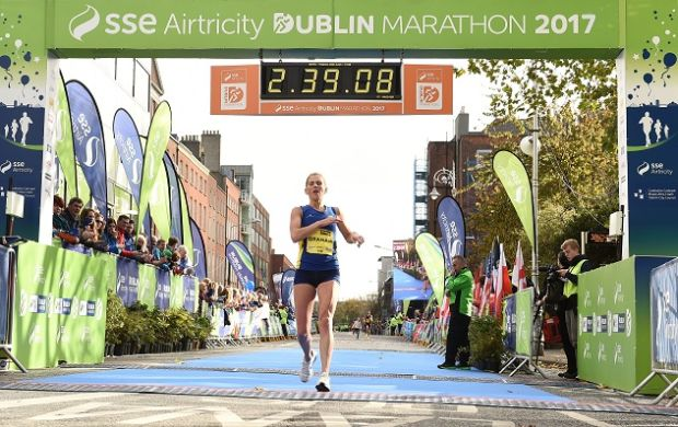 Laura Graham of Mourne Runners, Co Down, crosses the line to be the first Irish finisher in the women's category of the 2017 Dublin Marathon. Photograph: Sam Barnes/Sportsfile