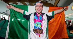 Gynmast Patrick Quinlivan from Letterkenny, Co Donegal with his haul of medals during the homecoming after the 2015 Special Olympics World Summer Games. Photograph: Cathal Noonan/Inpho