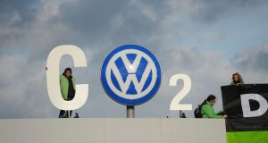 "Greenpeace activists demonstrate at the entrance to the Volkswagen  plant in Wolfsburg, Germany, in  2015. ""When a company runs afoul of the social consensus . . . investors have an opportunity."" Photograph:  Peter Steffen"